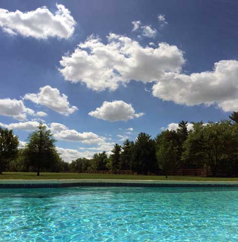 August 2016 clouds from in the pool