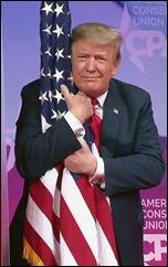 trump-hugs-flag_s